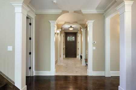 new construction: Foyer in new construction home with arched entry