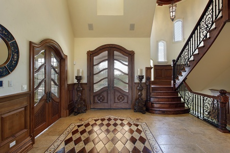 upscale: Foyer in luxury home with floor design Stock Photo