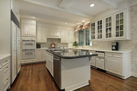 kitchen island: Kitchen in luxury home with cream colored cabinetry Stock Photo