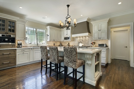 furnishings: Kitchen in luxury home with white cabinetry Stock Photo