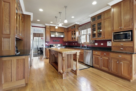 Kitchen in luxury home with wood center island