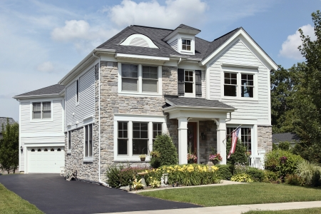 Home with stone front and covered entry Stock Photo - 8792979