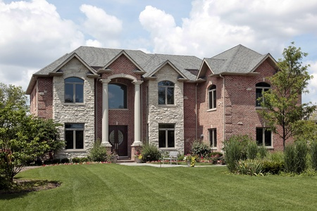 expensive: Brick home with stone front and white columns