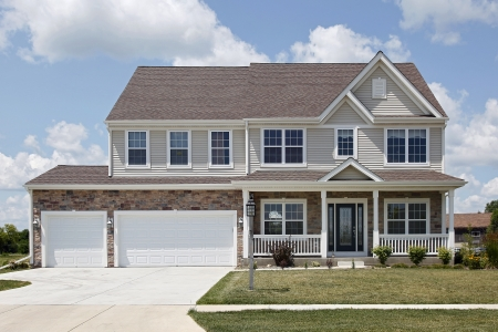 Stone two story home with front porch photo