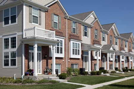 suburbs: Row of brick townhouses with covered entries