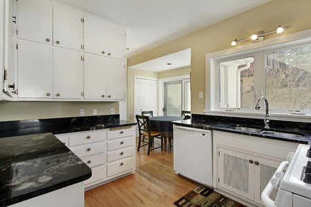 adjacent: Kitchen in suburban home with adjacent breakfast room Stock Photo