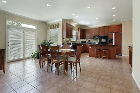 eating area: Large kitchen with redwood cabinetry and eating area