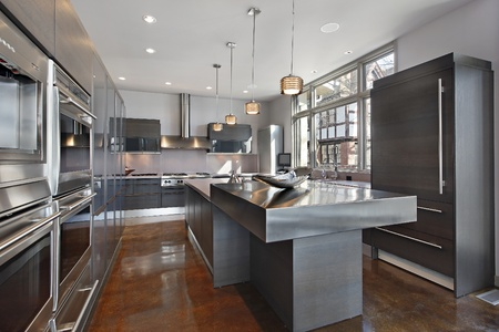 stainless steel kitchen: Ultra modern kitchen with stainless steel island Stock Photo