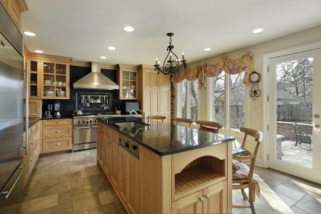 real kitchen: Kitchen in luxury home with oak wood cabinetry Stock Photo