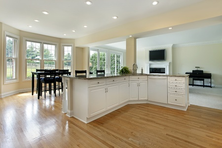 fixtures: Large kitchen in remodeled home with eating area