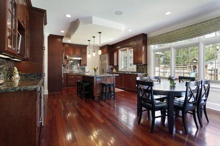 Kitchen in luxury home with cherry wood cabinetry Stock Photo