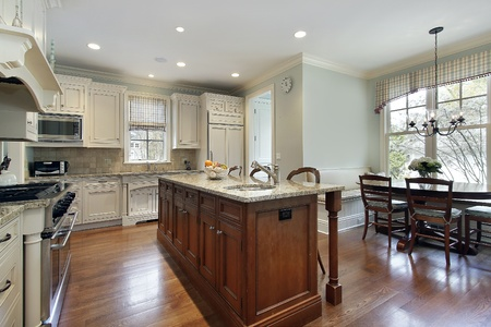 kitchen cabinets: Kitchen with center island and eating area