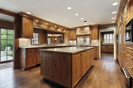 Traditional kitchen in luxury home with oak wood cabinetry photo