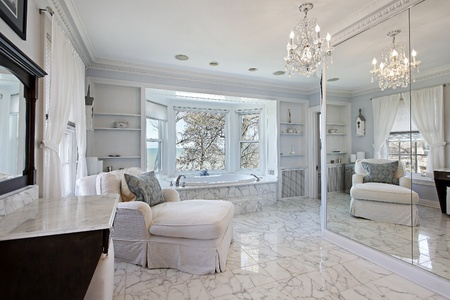 Master bath in luxury home with lake view photo