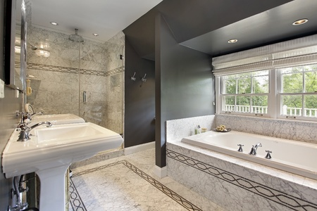 master: Modern master bath with marble flooring and glass shower Stock Photo
