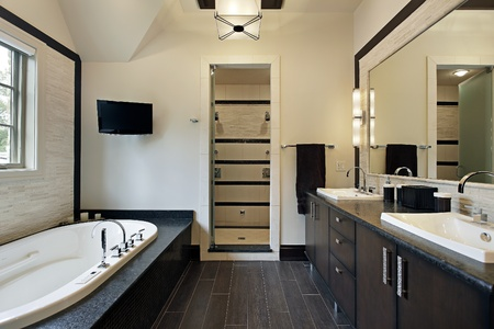 bathroom interior: Master bath in luxury home with dark wood cabinetry