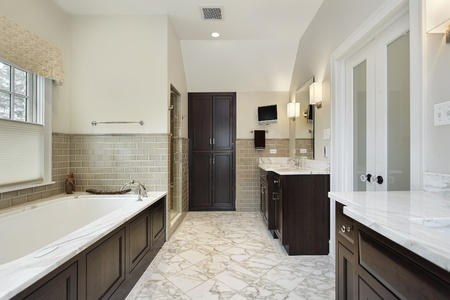 cabinetry: Master bath in luxury home with dark wood cabinetry