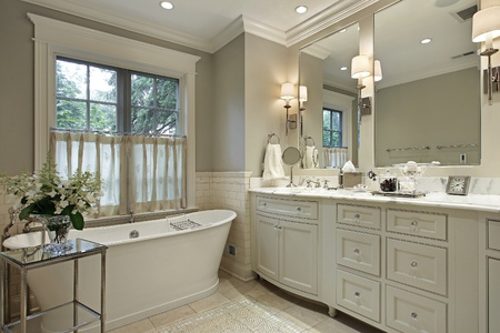 Master bath in luxury home with marble counter photo