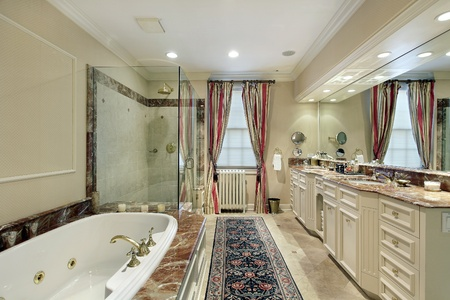 Master bath in luxury home with marble bath tub photo