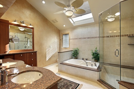 bathroom interior: Modern master bath with glass shower and skylight Stock Photo