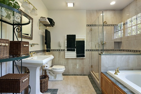 Master bath with glass shower tub with oak wood cabinetry photo