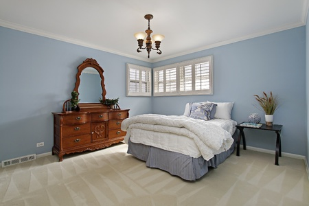 Master bedroom in suburban home with light blue walls Stock Photo - 8792924