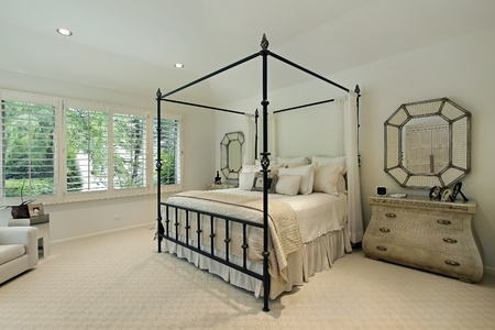 Master bedroom in luxury home with tray ceiling Stock Photo