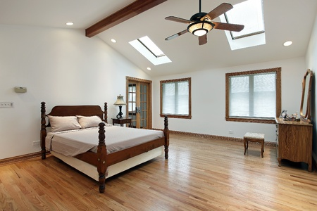 master: Master bedroom in luxury home with two skylights