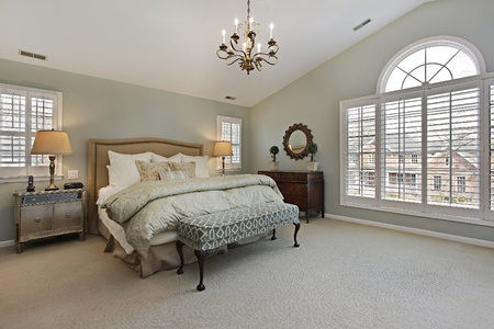 Master bedroom in luxury home with circular window photo