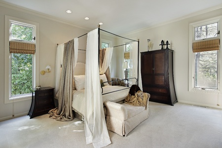 Master bedroom in luxury home with curtains around bed Stock Photo - 8792962