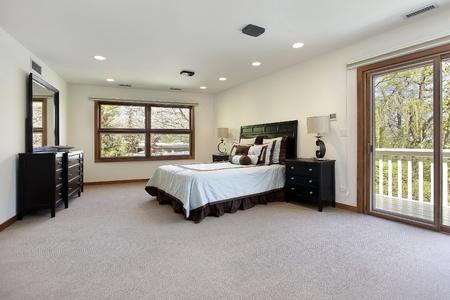 Master bedroom in luxury room with door to balcony Stock Photo - 8793012