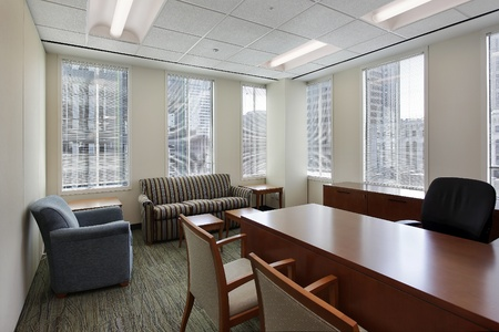 Corner office in downtown building with executive desk photo