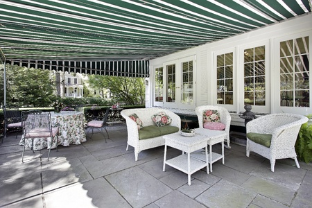 awning: Patio in luxury home with green awning Stock Photo