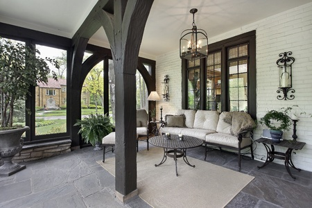 lighting fixtures: Porch with wood beams and stone flooring