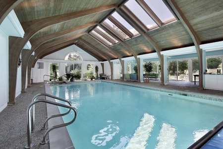 indoors: Large indoor swimming pool with six skylights