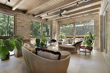 upscale: Sunroom in luxury home with wicker furniture