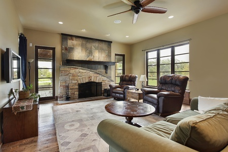furnishings: Family room in luxury home with stone fireplace