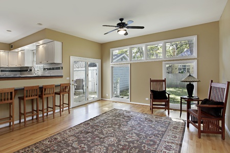 Family room in suburban home with doors to deck