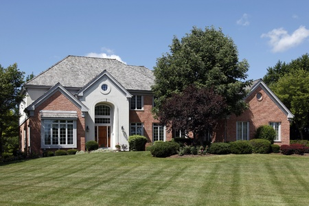 suburbs: Large home in suburbs with arched entry Stock Photo