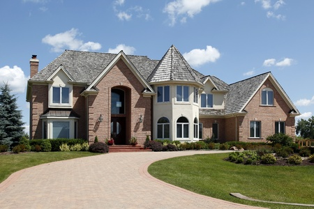 Large home in suburbs with turret and arched entry Stock Photo