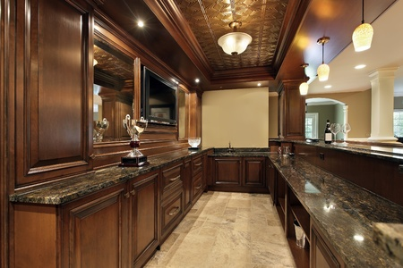 cabinetry: Bar in basement of luxury home with wood cabinetry Stock Photo