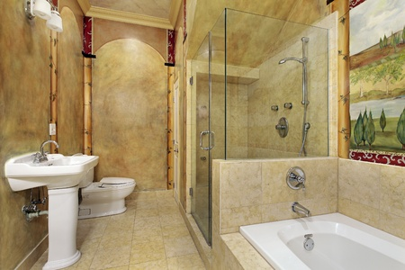 upscale: Master bath in luxury home with glass shower