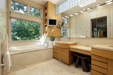 upscale: Master bath in luxury home with large picture window Stock Photo