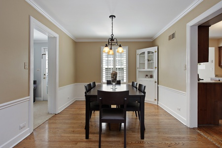 Dining room in suburban home with tan walls photo