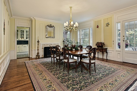 dining table and chairs: Large dining room in luxury home with fireplace