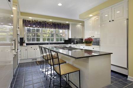 kitchen decoration: Kitchen in suburban home with granite counter