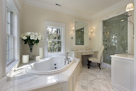bathroom interior: Master bath in luxury home with step up tub