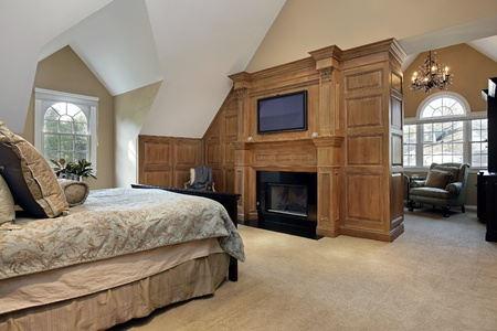 master bedroom in luxury home with fireplace photo - Luxury Homes Master Bedroom
