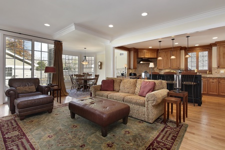 Family room with view into kitchen and breakfast area Stock Photo