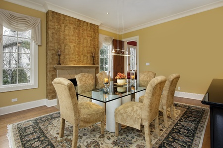 Dining room with gold walls and fireplace